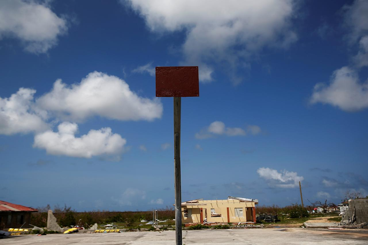 <p>An empty basketball hoop and backboard is seen among homes in ruin at Codrington on the island of Barbuda just after a month after Hurricane Irma struck the Caribbean islands of Antigua and Barbuda, October 7, 2017. REUTERS/Shannon Stapleton </p>