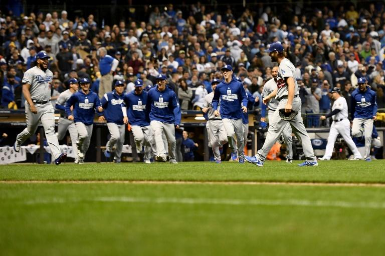 Pitcher Clayton Kershaw and his Dodgers teammates celebrate after booking a return trip to the World Series with a 5-1 win over the Milwaukee Brewers