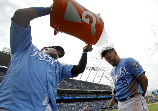 Kansas City Royals' Drew Butera (9) is doused by Salvador Perez after their baseball game against the Minnesota Twins, Sunday, July 22, 2018, in Kansas City, Mo. (AP Photo/Charlie Riedel)