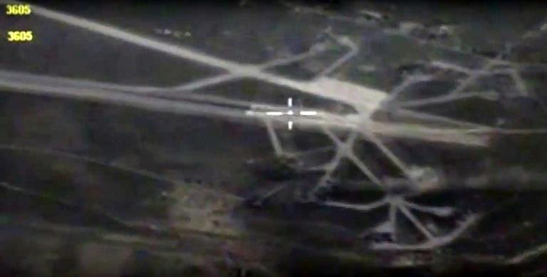 A handout grab image made on April 8, 2017 from a video made available by the Russian Defence Ministry's press service on the official website of the Russian Defence Ministry shows landing and strips at the Shayrat airbase after it was hit by US
