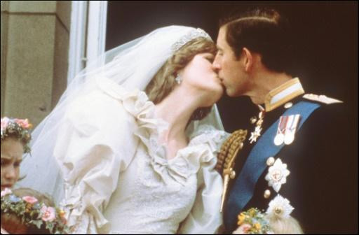 Prince Charles and his new wife, Lady Diana, kiss on the balcony of Buckingham Palace before a huge crowd in 1981