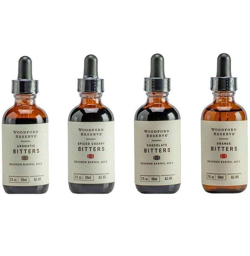 """<p><strong>Woodford Reserve</strong></p><p>amazon.com</p><p><strong>$43.37</strong></p><p><a href=""""https://www.amazon.com/dp/B0727V3N6N?tag=syn-yahoo-20&ascsubtag=%5Bartid%7C10054.g.3047%5Bsrc%7Cyahoo-us"""" rel=""""nofollow noopener"""" target=""""_blank"""" data-ylk=""""slk:Buy"""" class=""""link rapid-noclick-resp"""">Buy</a></p><p>With these aromatic, spiced cherry, orange, and chocolate bitters aged in Woodford Reserve bourbon barrels, a cocktail will never taste boring again. </p>"""