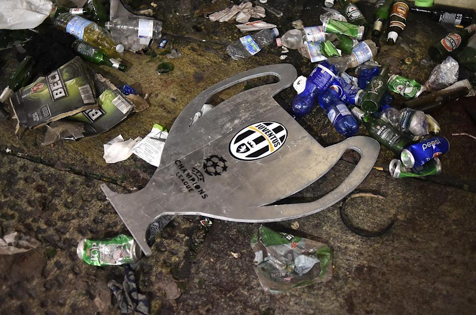 <p>Football Soccer – Juventus v Real Madrid – UEFA Champions League Final – San Carlo Square, Turin, Italy – June 3, 2017 A cardboard shaping the Champions League cup is seen on the ground left in San Carlo Square by crowd gather to watch the match and ran away following panic created by the explosion of firecrackers on June 3, 2017. (Giorgio Perottino/Reuters) </p>
