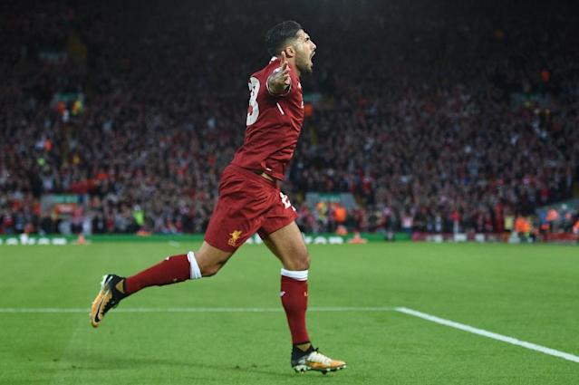 Liverpool's midfielder Emre Can celebrates scoring the team's first goal during the Champions League qualifier, second leg match against Hoffenheim August 23, 2017 (AFP Photo/Oli SCARFF )