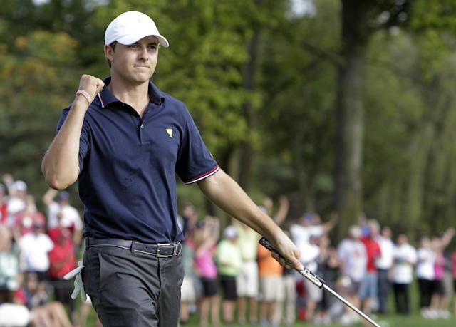 United States team player Jordan Spieth celebrates his birdie putt on the 10th hole during a four-ball match at the Presidents Cup golf tournament at Muirfield Village Golf Club Thursday, Oct. 3, 2013, in Dublin, Ohio. Spieth and Steve Stricker won 1-up against the International team's Ernie Els and Brendon de Jonge. (AP Photo/Jay LaPrete)