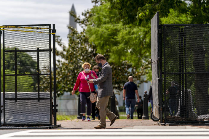 Lafayette Park, across the street from the White House, reopens in a limited capacity in Washington, Monday, May 10, 2021. Fencing remains in place around the park which will allow the Secret Service to temporarily close the park as they deem necessary. (AP Photo/Andrew Harnik)