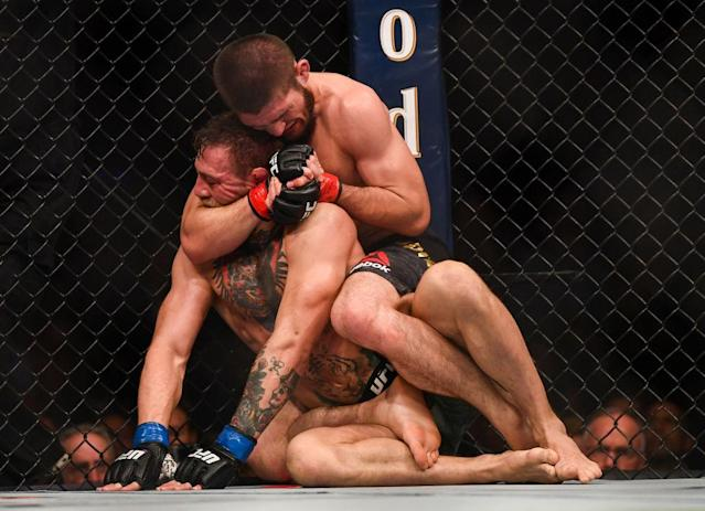 Khabib Nurmagomedov locks down Conor McGregor. (Getty)