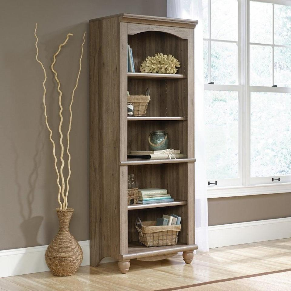 <p>This <span>Sauder Cottage Road Library with Doors</span> ($179, originally $205) is the perfect addition to your farmhouse decor style. According to reviewers, the sturdy piece of furniture is easy to put together.</p>