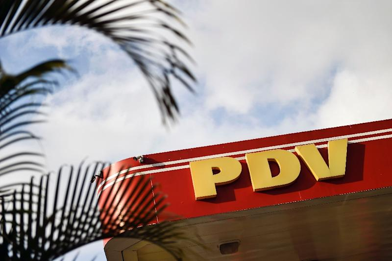 The United States is banning exports by Venezuelan state-owned oil company PDVSA, whose logo is seen here at a gas station in Caracas (AFP Photo/LUIS ROBAYO)