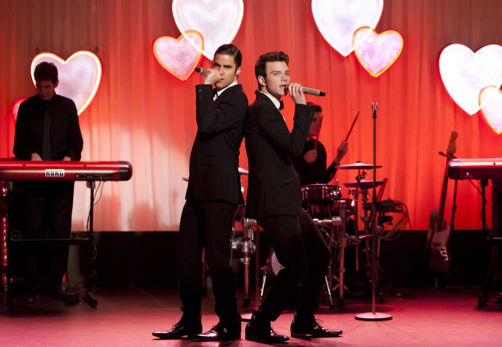 "Blaine (Darren Criss) and Kurt (Chris Colfer) perform at Will and Emma's wedding in the ""I Do"" episode of ""Glee."""