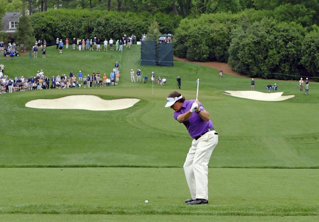 Phil Mickelson prepares to his his tee shot on the 13th hole during the second round of the Wells Fargo Championship golf tournament in Charlotte, N.C., Friday, May 2, 2014. (AP Photo/Chuck Burton)