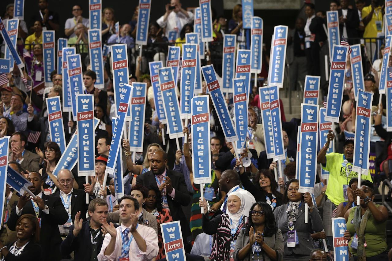 Delegates cheer as First Lady Michelle Obama addresses the Democratic National Convention in Charlotte, N.C., on Monday, Sept. 3, 2012. (AP Photo/Charles Dharapak)