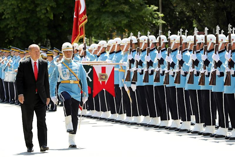 Turkey's Erdogan begins new term with purge of 18,600 civil servants