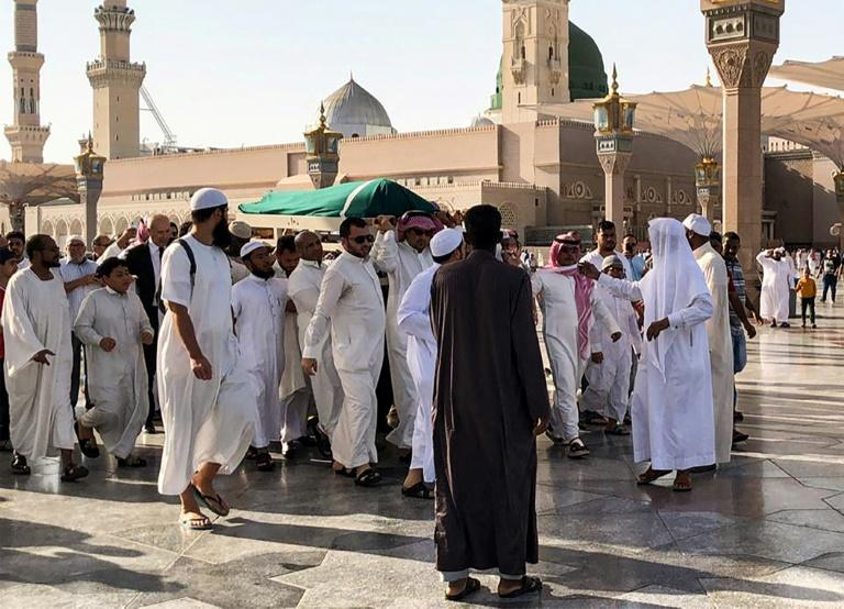 Mourners carry the body of former Tunisian president Zine El Abidine Ben Ali during his funeral in Saudi Arabia's holy city of Medina