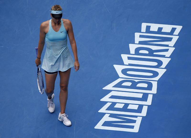 Maria Sharapova of Russia walks on the court as she plays Alize Cornet of France during their third round match at the Australian Open tennis championship in Melbourne, Australia, Saturday, Jan. 18, 2014. (AP Photo/Eugene Hoshiko)