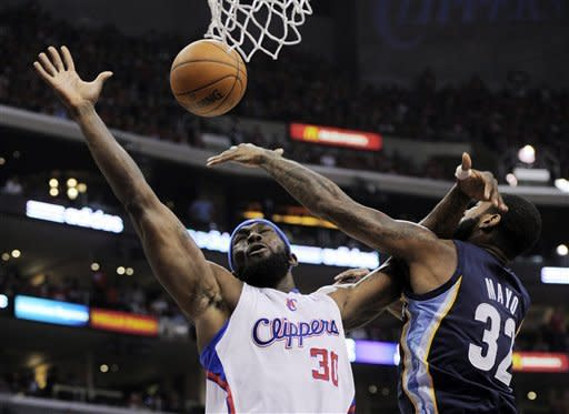 Los Angeles Clippers forward Reggie Evans (30) puts up a shot as Memphis Grizzlies guard O.J. Mayo defends during the first half of Game 3 in their first-round NBA basketball playoff series, Saturday, May 5, 2012, in Los Angeles. (AP Photo/Mark J. Terrill)