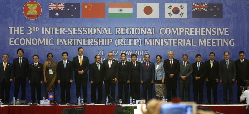 Trade ministers of 16 countries from the Asia-Pacific region stand for a group photo during the Regional Comprehensive Economic Partnership (RCEP) ministerial meeting in Hanoi, Vietnam on Monday, May 22, 2017. The ministers gather in Hanoi to speed up finalization of the China-led trade agreement by the end of this year. (AP Photo/Hau Dinh)