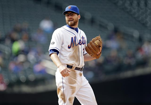 New York Mets' Daniel Murphy stands during the seventh inning of a baseball game against the Washington Nationals at Citi Field, Thursday, April 3, 2014, in New York. Murphy is proud he put fatherhood ahead of baseball, and New York Mets manager Terry Collins thinks criticism his second baseman received for taking paternity leave this week was unfair. Murphy made his season debut Thursday three days after the birth of son Noah. (AP Photo/Seth Wenig)