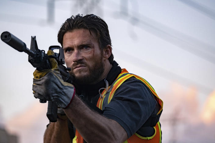 """This image released by Metro Goldwyn Mayer Pictures shows Scott Eastwood in a scene from """"Wrath of Man,"""" a film by Guy Ritchie. (Scott Garfield/Metro Goldwyn Mayer Pictures via AP)"""
