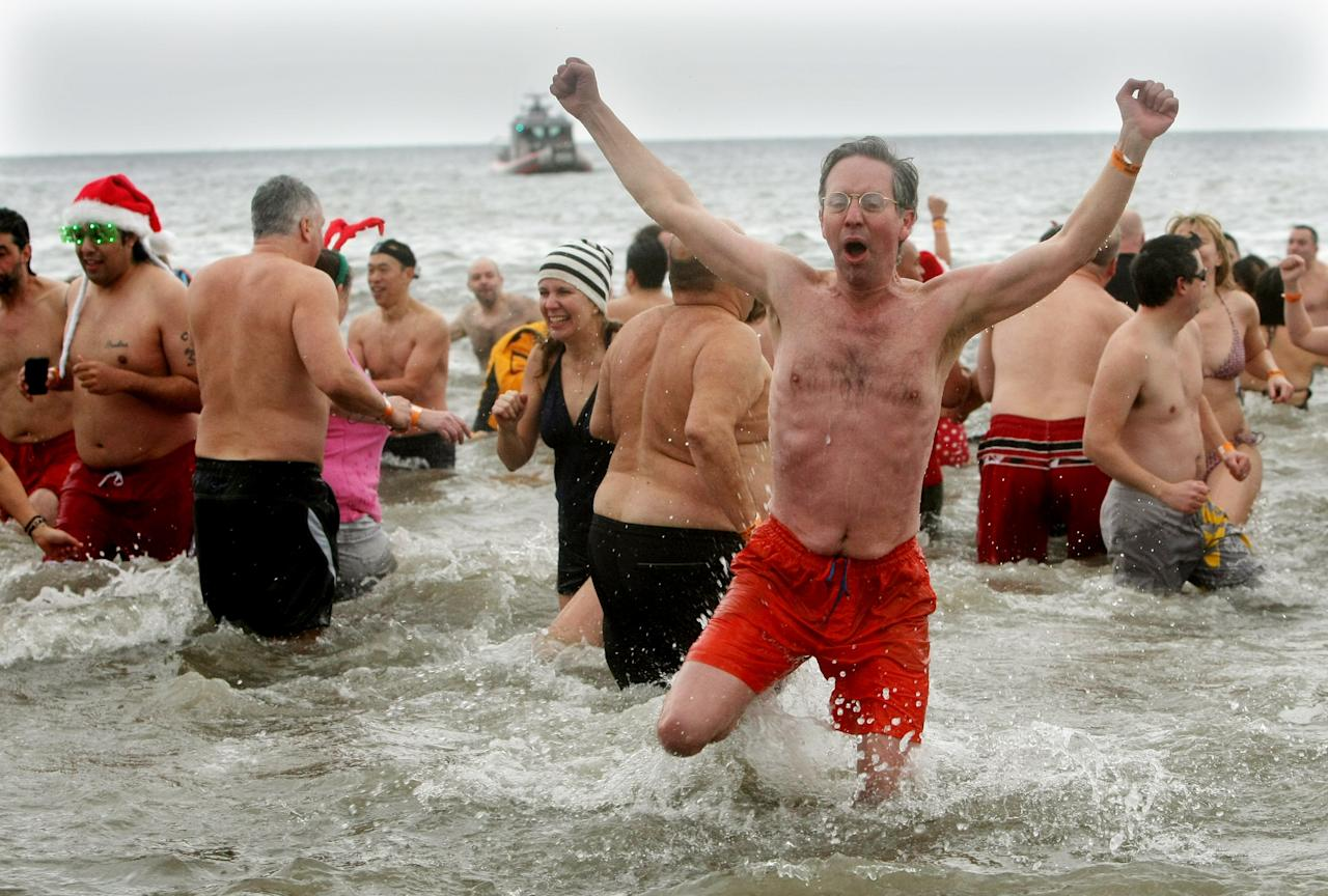 NEW YORK, NY - JANUARY 1: A man reacts after plunging into the frigid water during the Coney Island Polar Bear Club's New Year's Day swim on January 1, 2013 in the Coney Island neighborhood of the Brooklyn borough of New York City. The annual event attracts hundreds who brave the icy Atlantic waters and temperatures in the upper 30's as a way to celebrate the first day of the new year. (Photo by Monika Graff/Getty Images)