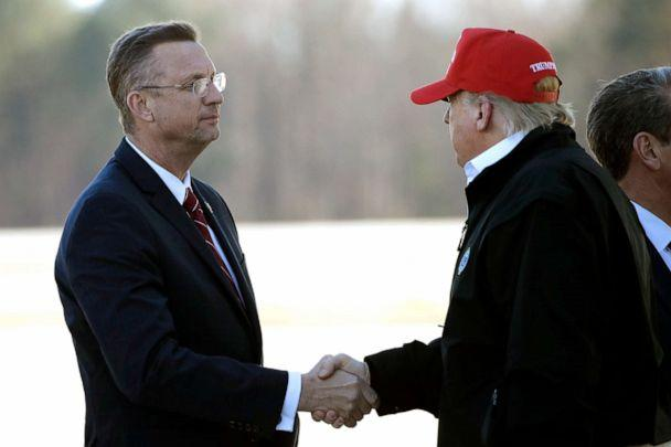 PHOTO: President Donald Trump greets Rep. Doug Collins as he arrives on Air Force One, March 6, 2020, at Dobbins Air Reserve Base in Marietta, Ga. (Alex Brandon/AP)