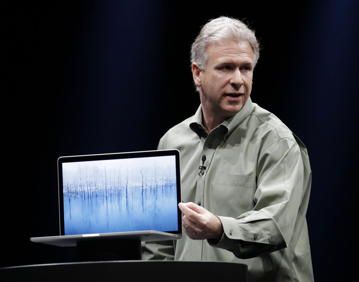 Apple's Phil Schiller speaks about the new MacBook Pro at the Apple Developers Conference in San Francisco, Monday, June 11, 2012. The MacBook Pro, will get a new Intel chip and prices for the 13-inch model will be $1,199 to $1,499, while a 15-inch model will be $1,799 or $2,199, depending on the amount of storage. The new MacBook Air and MacBook Pro models will start shipping Monday. (AP Photo/Paul Sakuma)