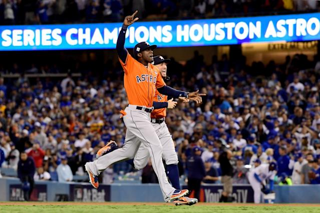 "The Astros' Cameron Maybin, left, and George Springer celebrate after Houston beat the Dodgers in Game 7 to win the 2017 World Series. Earlier this year, MLB concluded that the Astros illegally stole signs that season. <span class=""copyright"">(Harry How / Getty Images)</span>"