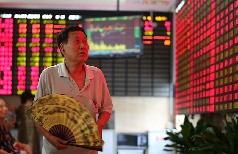An investor looks at a stock price monitor at a private securities company on Tuesday July 9, 2013 in Shanghai, China. Asian stock markets rebounded Tuesday, joining a global rally following positive U.S. economic news as nervousness about an imminent scaling back of the Federal Reserve's monetary stimulus eased. (AP Photo)