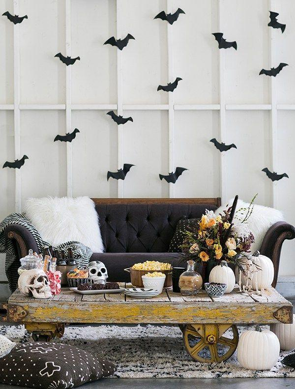 "<p>If you're hosting a scary movie night, bring the on-screen horror to life with some scary decor. An on-theme bouquet surrounded by pumpkins and a skull decanter for the table and some flying <a href=""https://www.marthastewart.com/852559/hanging-bats"" rel=""nofollow noopener"" target=""_blank"" data-ylk=""slk:paper bats"" class=""link rapid-noclick-resp"">paper bats</a> for the walls will do. Floor cushions promise extra seating—power in numbers when it comes to scary movie marathons. Find out more from <a href=""https://sugarandcharm.com/2016/09/charming-halloween-movie-night.html?section-23"" rel=""nofollow noopener"" target=""_blank"" data-ylk=""slk:Sugar and Charm"" class=""link rapid-noclick-resp"">Sugar and Charm</a>. </p><p><a class=""link rapid-noclick-resp"" href=""https://www.amazon.com/RiteCo-24506-Construction-Paper-Black/dp/B01NH9ZOC2/ref=sr_1_2?tag=syn-yahoo-20&ascsubtag=%5Bartid%7C10057.g.2554%5Bsrc%7Cyahoo-us"" rel=""nofollow noopener"" target=""_blank"" data-ylk=""slk:BUY NOW"">BUY NOW</a> <strong><em>Black Construction Paper, $13</em></strong></p>"