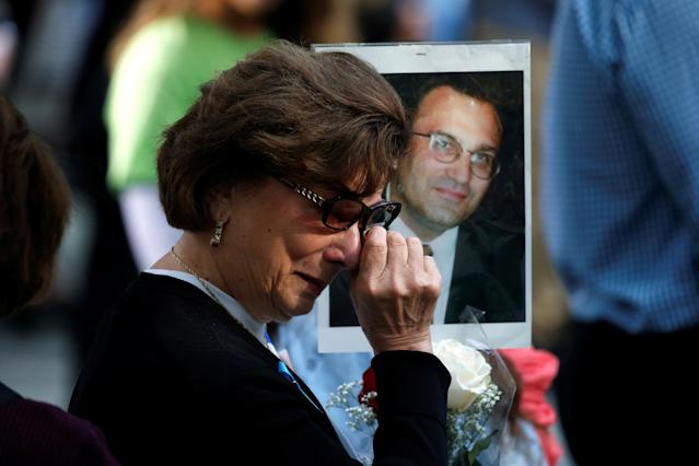 <p>A woman wipes away tears as she holds a photograph of Alex Ciccone, a victim of the Sept. 11, 2001, attacks on the World Trade Center, at the National 9/11 Memorial and Museum during ceremonies marking the 16th anniversary of the attacks in New York, Sept. 11, 2017. (Photo: Brendan McDermid/Reuters) </p>