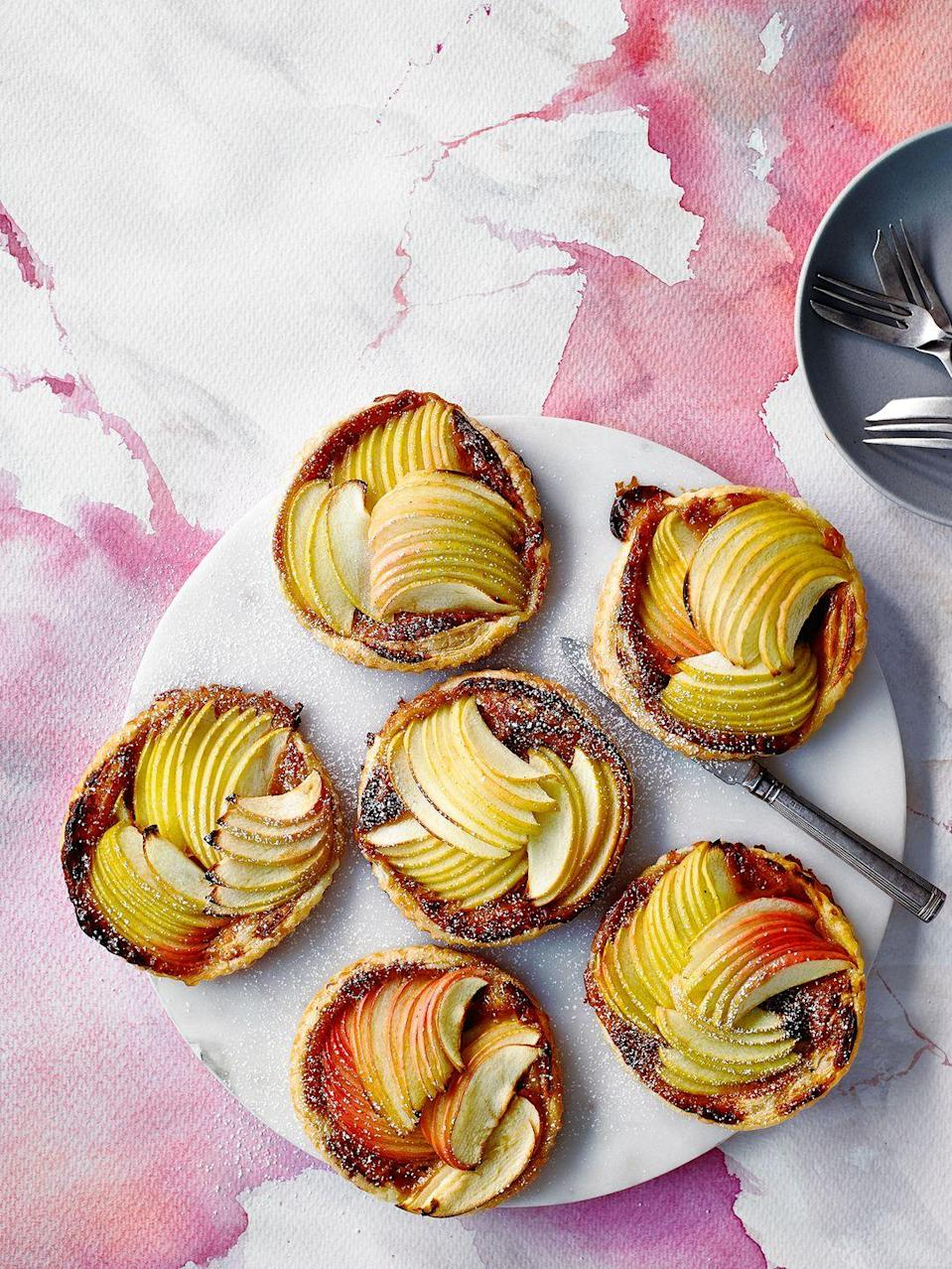 """<p>So delicious and impressive, your guests will never know you took shortcuts! These taste great with a ball of vanilla ice cream or some pouring cream.</p><p><strong>Recipe: <a href=""""https://www.goodhousekeeping.com/uk/food/recipes/a26943008/easy-apple-tart/"""" rel=""""nofollow noopener"""" target=""""_blank"""" data-ylk=""""slk:Three-ingredient Apple Tarts"""" class=""""link rapid-noclick-resp"""">Three-ingredient Apple Tarts</a></strong></p>"""