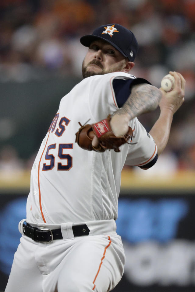 Houston Astros relief pitcher Ryan Pressly throws against the New York Yankees during the seventh inning in Game 1 of baseball's American League Championship Series Saturday, Oct. 12, 2019, in Houston. (AP Photo/Eric Gay)