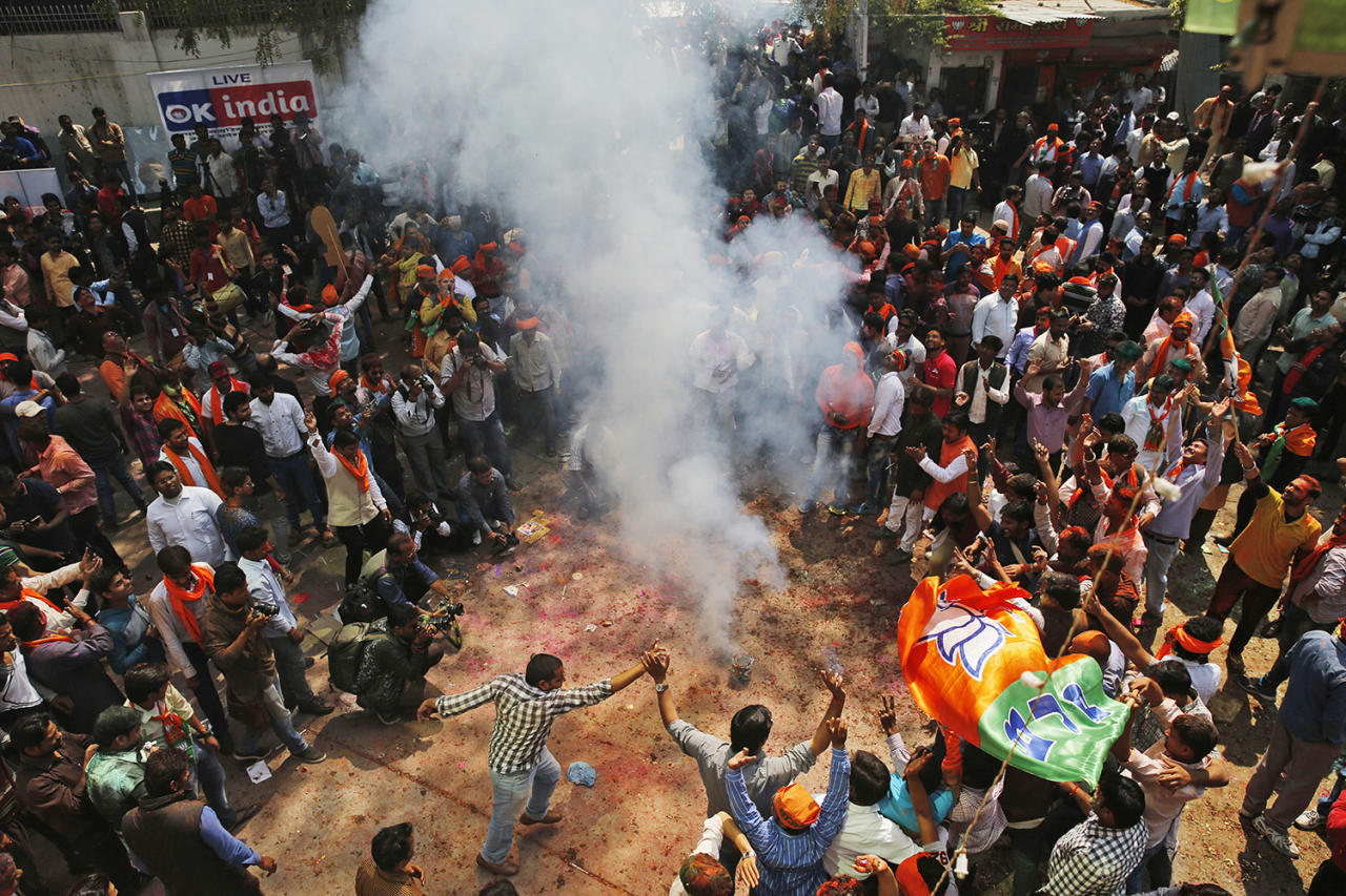 <p>Bharatiya Janata Party supporters celebrate winning seats in the Uttar Pradesh state legislature elections in, Lucknow, India, March 11, 2017. (Photo: Rajesh Kumar Singh/AP) </p>