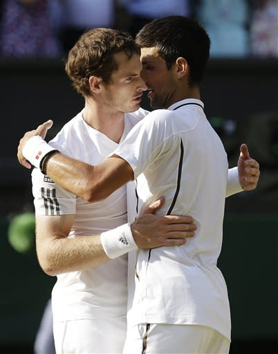 Andy Murray of Britain, left, embraces Novak Djokovic of Serbia after winning the Men's singles final match at the All England Lawn Tennis Championships in Wimbledon, London, Sunday, July 7, 2013. (AP Photo/Anja Niedringhaus, Pool)
