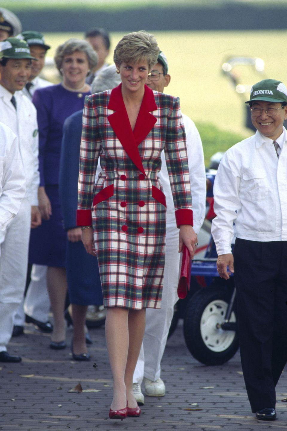 <p>In a checkered coatdress by Catherine Walker on the Official Tour of Japan. </p>