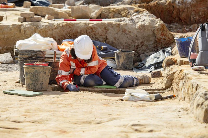 A worker at Central Station which was once Devonshire Street Cemetery. The grave of Joseph Thompson was found here recently during works on Sydney Metro. The grave is 161 years old.