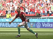 Hungary's Attila Fiola celebrates after scoring his sides first goal during the Euro 2020 soccer championship group F match between Hungary and France at the Ferenc Puskas stadium in Budapest, Hungary Saturday, June 19, 2021. (Tibor Illyes/Pool via AP)