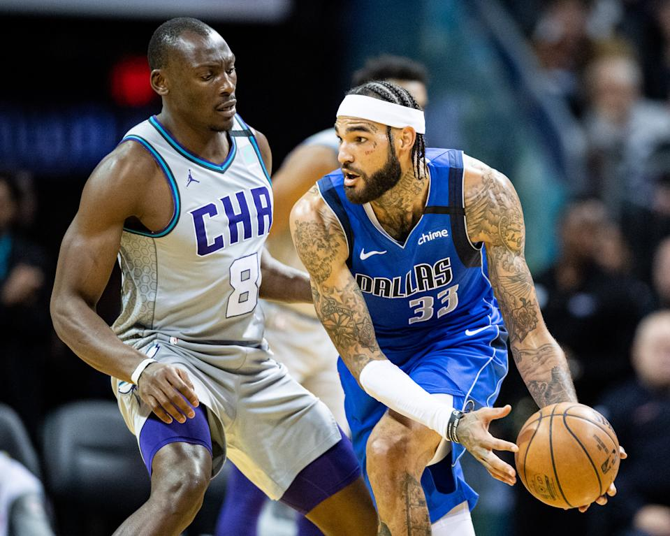 Bismack Biyombo #8 of the Charlotte Hornets defends against Willie Cauley-Stein #33 of the Dallas Mavericks.