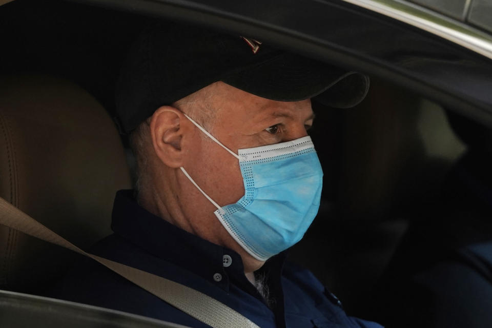 Peter Daszak of the World Health Organization team sits in a car on his way to a field visit in Wuhan in central China's Hubei province on Friday, Jan. 29, 2021. Daszak, part of the team investigating the origins of the coronavirus in Wuhan, says the Chinese side granted full access to all sites and personnel they requested to visit and meet with. (AP Photo/Ng Han Guan)