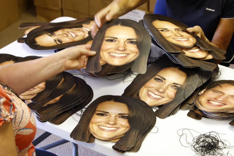 Workers from the Mask-arade mask company sort Kate, Duchess of Cambridge masks ready for dispatch at the company works in Southam , England Thursday June 6, 2013. Mask-arade are in overdrive printing masks of Kate and William for the street parties that will follow the announcement of the birth of the Royal baby, expected in July. Normally, the company has 2,000 masks on hand. But for the royal birth, they will whip up 20,000 to meet the expected demand. (AP Photo/Martin Cleaver)