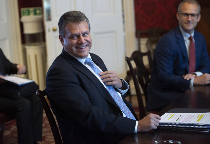 """EU Commission Vice President Maros Sefcovic, smiles during a meeting with Britain's Minister for the Cabinet Office of the United Kingdom, David Frost, in London, Wednesday, June 9, 2021. The U.K. has called upon the European Union to show pragmatism and """"common sense,"""" as the two sides meet to resolve differences over the deal that was supposed to keep trade flowing in Northern Ireland after Brexit. (Eddie Mulholland/Pool Photo via AP)"""