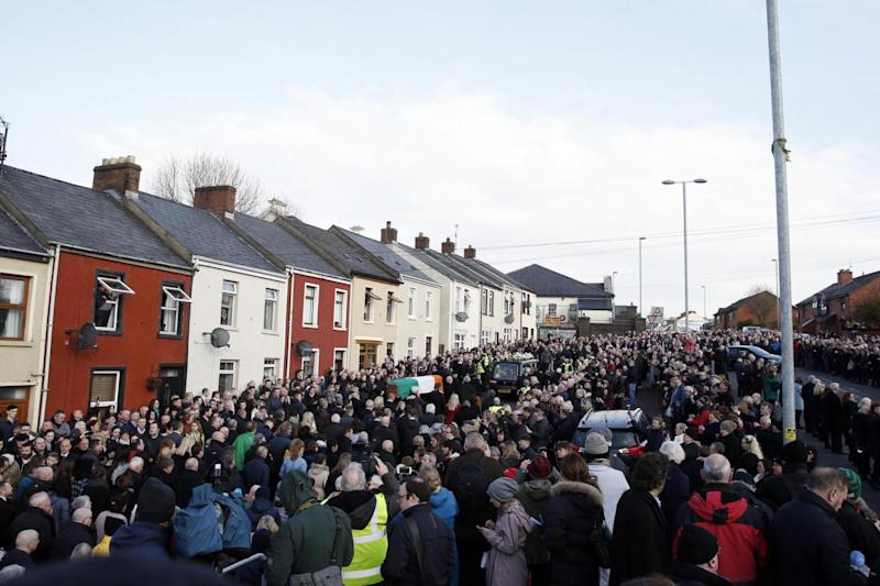 Funeral: The coffin of Martin McGuinness is carried from St Columba's Church in Londonderry (AP)