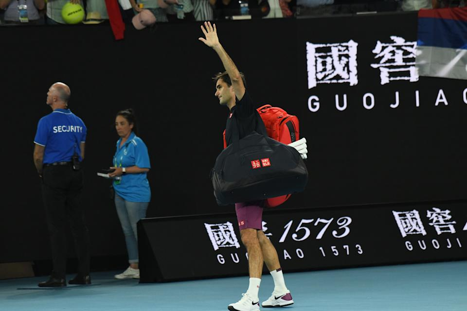 MELBOURNE, AUSTRALIA - JANUARY 30: Roger Federer of Switzerland walks off court after losing the Australia Open men's singles semifinal match against Novak Djokovic (not seen) of Serbia in Melbourne, Australia on January 30, 2020. Djokovic advanced to final after beating Federer 3 to 0. (Photo by Recep Sakar/Anadolu Agency via Getty Images)