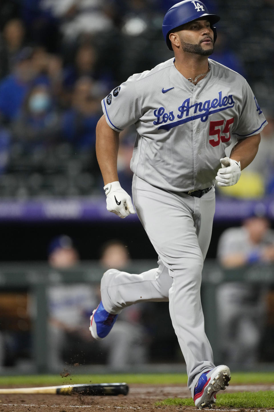 Los Angeles Dodgers pinch-hitter Albert Pujols runs up the first-base line after popping out against Colorado Rockies relief pitcher Lucas Gilbreath in the ninth inning of a baseball game Wednesday, Sept. 22, 2021, in Denver. The Rockies won 10-5. (AP Photo/David Zalubowski)