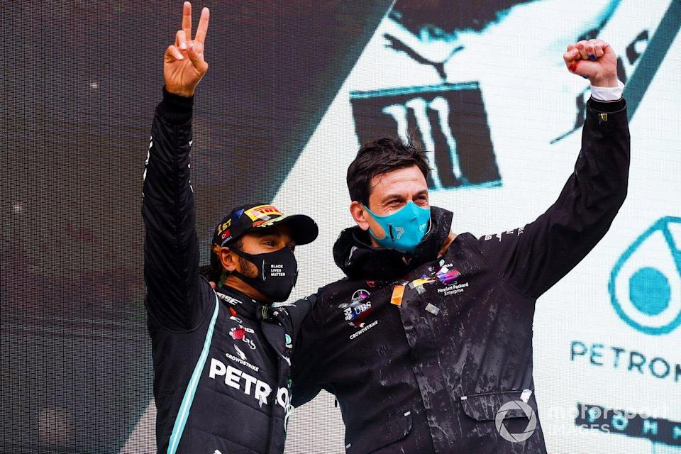 "Race Winner Lewis Hamilton, Mercedes-AMG F1 and Toto Wolff, Executive Director (Business), Mercedes AMG celebrate on the podium <span class=""copyright"">Steven Tee / Motorsport Images</span>"