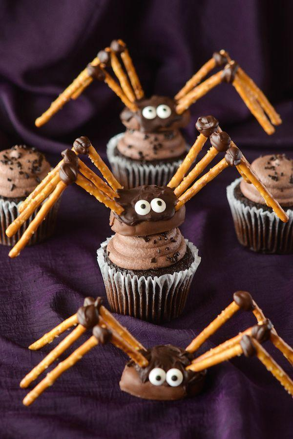 """<p>These oh-so-cute cupcakes are topped with chocolate pretzel spiders—the perfect """"ingredient"""" for your kids to help make this Halloween. </p><p><strong>Get the recipe at </strong><a href=""""http://www.thenovicechefblog.com/2015/09/diy-pretzel-chocolate-spiders/"""" rel=""""nofollow noopener"""" target=""""_blank"""" data-ylk=""""slk:The Novice Chef"""" class=""""link rapid-noclick-resp""""><strong>The Novice Chef</strong></a>. </p>"""