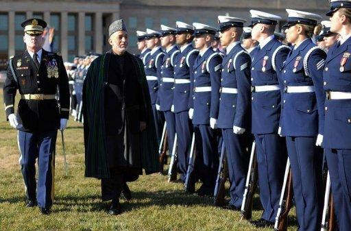 <p>Afghan President Hamid Karzai attends a military ceremony at the Pentagon in Washington DC on January 10, 2013. The US sought to assure Karzai that it would remain committed to his country even as US officials weigh a major withdrawal of American forces.</p>