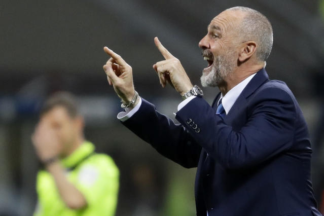 FILE - In this Monday, April 3, 2017 file photo, Inter Milan coach Stefano Pioli gives indications to his players during a Serie A soccer match between Inter Milan and Sampdoria, at the San Siro stadium in Milan, Italy. AC Milan has hired Stefano Pioli as its new coach on a two-year contract. Pioli, who has previously coached the Rossoneris city rival Inter Milan, replaces the fired Marco Giampaolo. (AP Photo/Antonio Calanni, File)