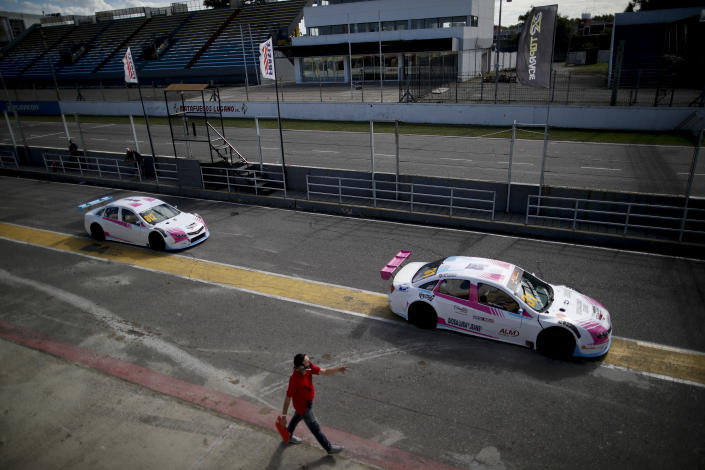 Vitarti Girl's Team drivers Karina Dobal, right, and Rocio Migliore leave the pits in their race cars for a practice session at the Oscar y Juan Galvez track in Buenos Aires, Argentina, Friday, April 2, 2021. They are the first all-female team in Argentina's motorsport history. (AP Photo/Natacha Pisarenko)