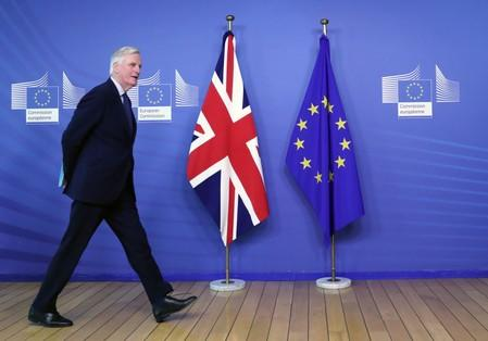 EU Chief Brexit Negotiator Barnier walks at EC HQ in Brussels